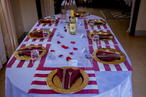 Gold charger plates and table decorations by Blessed HANDS DECOR Services