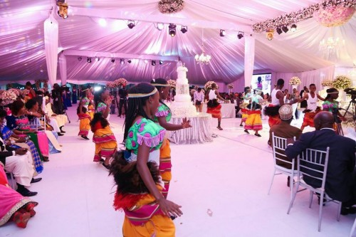 The Dance N' Beats Cultural Troupe entertaining guests at a wedding ceremony in Kampala