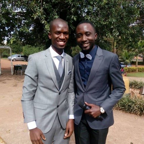 The Emcee with the groom, Thank you Mr & Mrs Kiyaga
