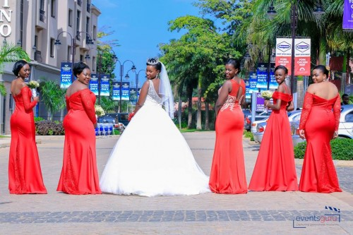 Prossy & her maids clad in red dresses