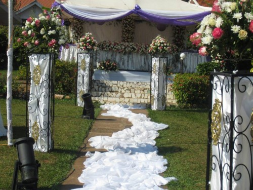 A bridal high table and walk way being set up at Bunga Leisure Gardens