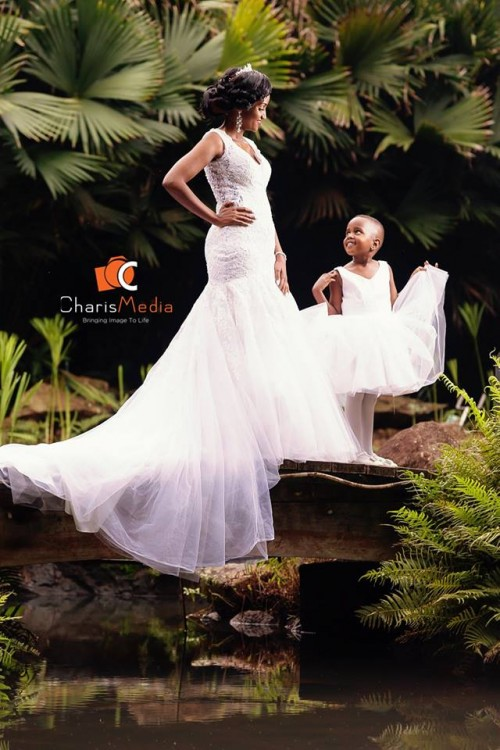A bride and her flower girl, wedding photo shoot at Speke Resort Munyonyo