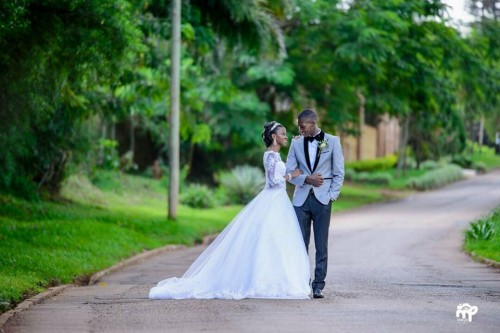 A Bride & Groom in a street photo shot powered by Makula Pictures