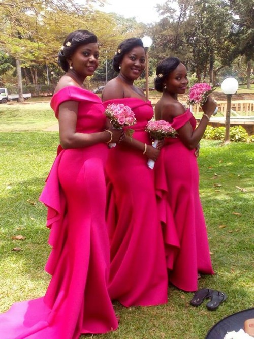 Bridesmaids in beautiful red tailored dresses from Bridal Lounge Kampala