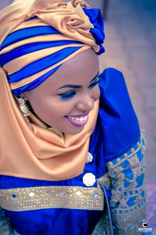 A gorgeous bride in a blue gomesi and a hijab at an introduction