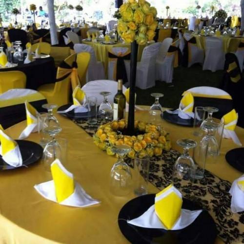Yellow, black & gold themed wedding decorations at Paya Gardens Nakulabye