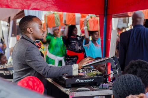 Dj Moustey Mustapha on the turntables at an introduction ceremony, Music by Real Sounds