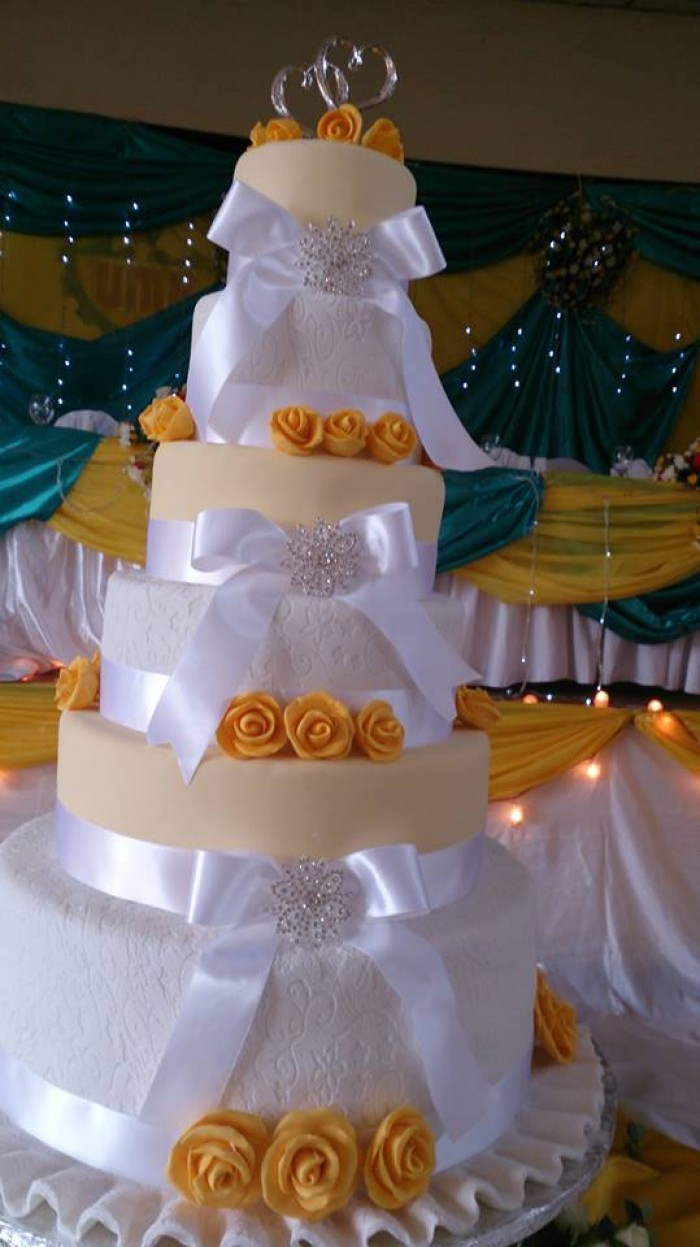 A six tier wedding cake by Real Cakes Uganda
