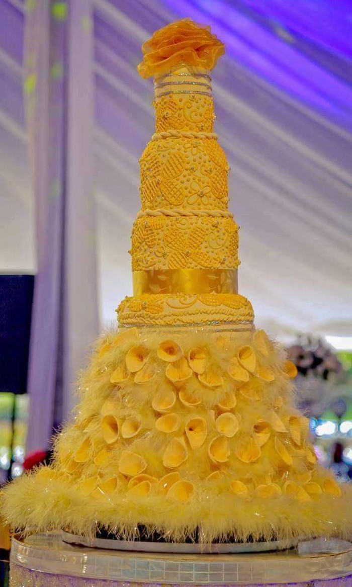 A beautiful golden yellow cake by Real Cakes Uganda