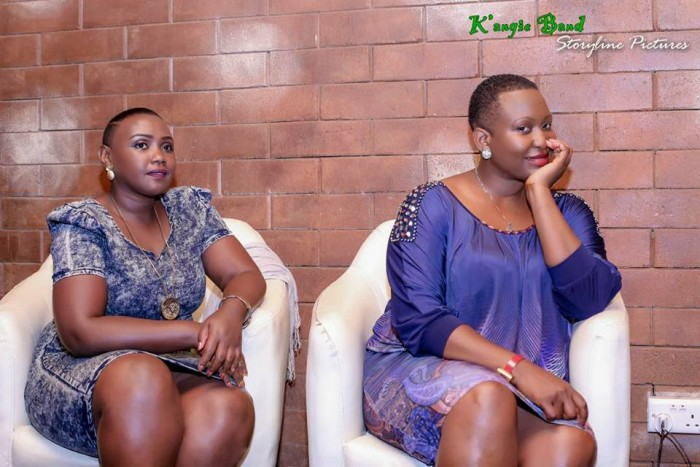 Angela Kalule waiting to perform with a colleague