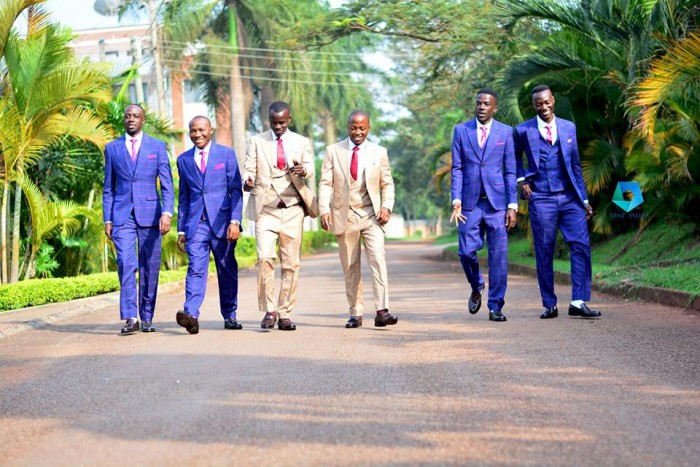 Groomsmen during a photo shoot by Lenz Media