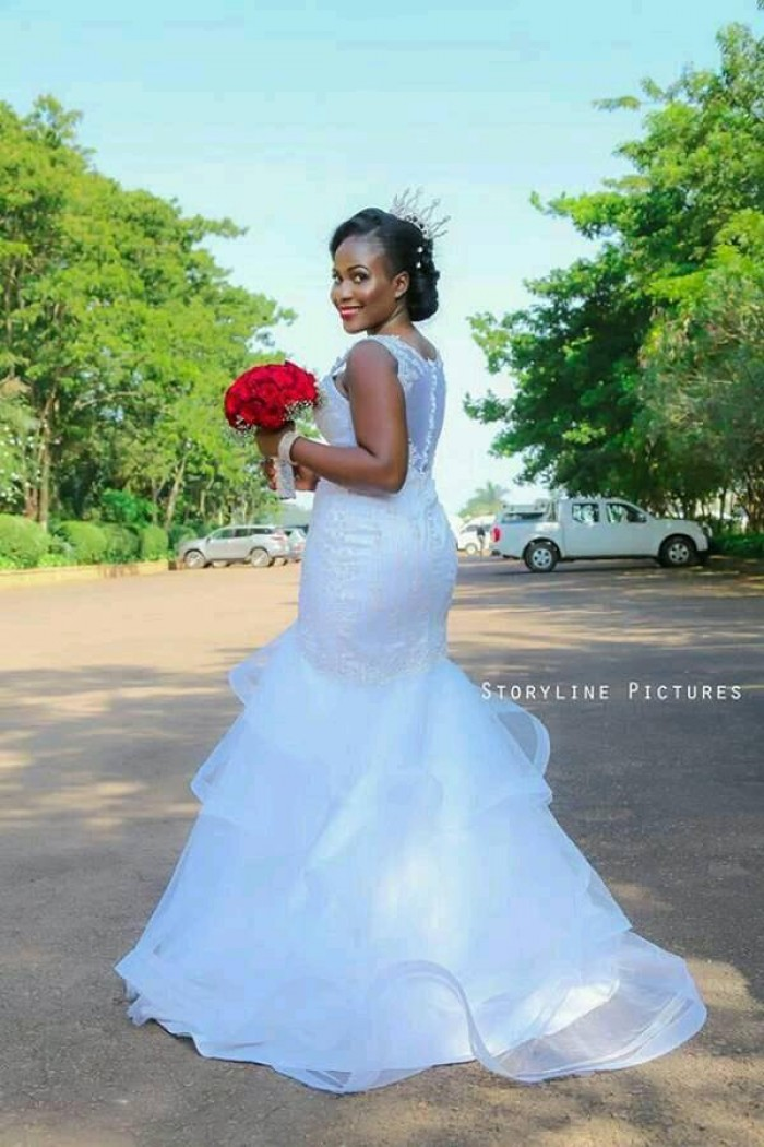 A beautiful Ugandan bride in mermaid gown from Peponi Clothings, photo by Storyline PictureUg