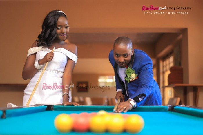 A bride & groom playing pool table during a wedding photo shoot by Rossy Roots Events