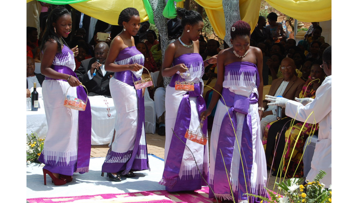 Ladies dazzle in the half gomesi inspired outfits, moments captured by Dream Occasions Ug