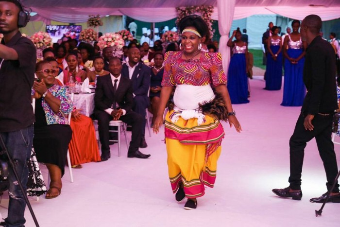 Flavia Namulindwa of The Dance N' Beats Cultural Troupe performs at wedding