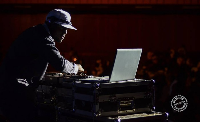 A deejay on the time tables at an event