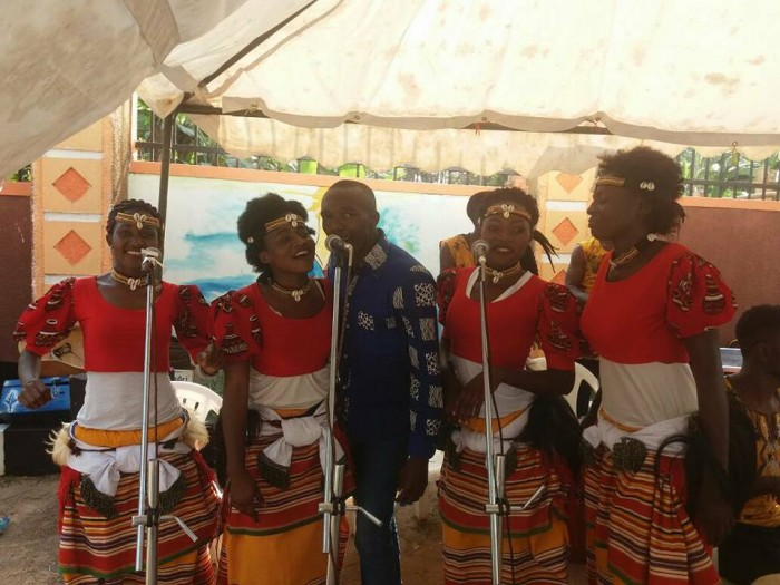 Ladies from Nyange Cultural Performers sing at Regina's introduction