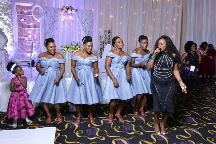 Rema Namakula performing at a wedding at Hotel Africana