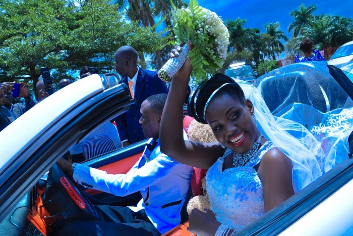 Wilson & Rosette driving from church on their wedding day