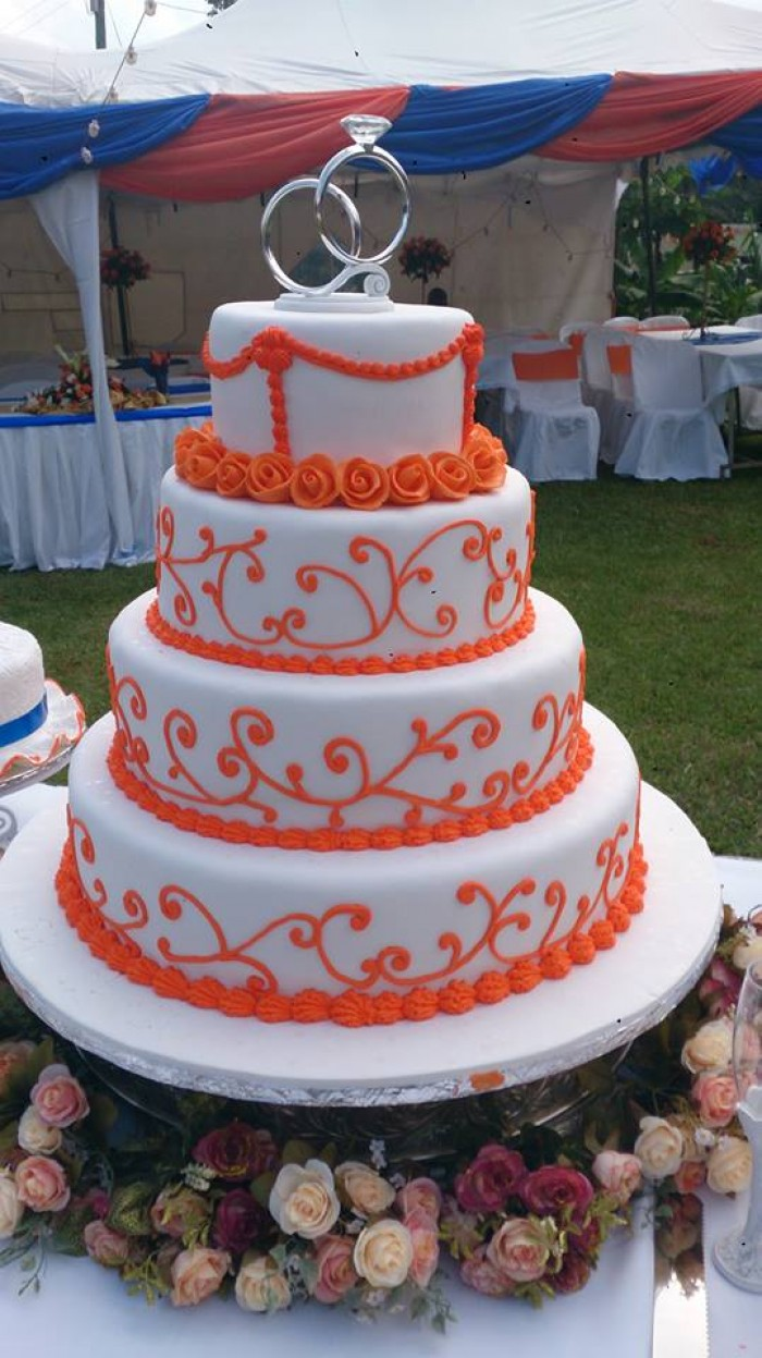 Beautifully designed wedding cake by Real Cakes Uganda