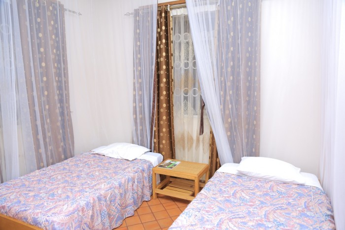 A standard double room at Adonai Guesthouse in Muyenga