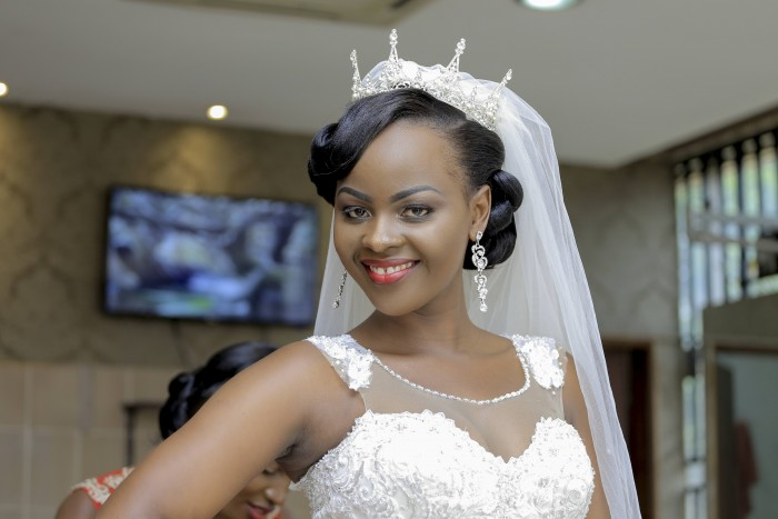 The dazzling Patience on her wedding day with Charles covered by Rossy Roots Photography