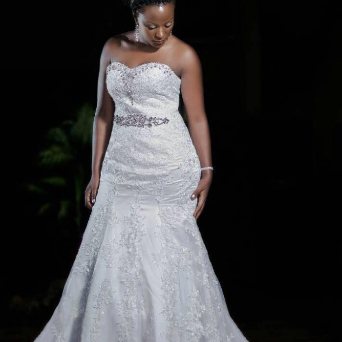 A model bride in a strapless mermaid wedding dress from Nisha's Bridal