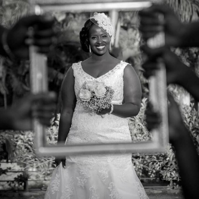 A gorgeous bride dressed by Nisha's Bridal posing for a photo moment on her wedding