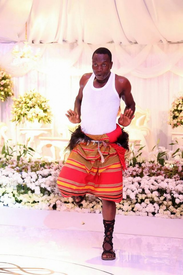 A member of The Dance N' Beats Cultural Troupe dances at wedding