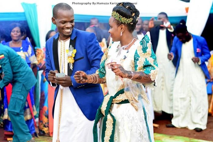 Paul & Olivia dance to the rhythm at their introduction, shots by Hamuza Karizma Kaweesi