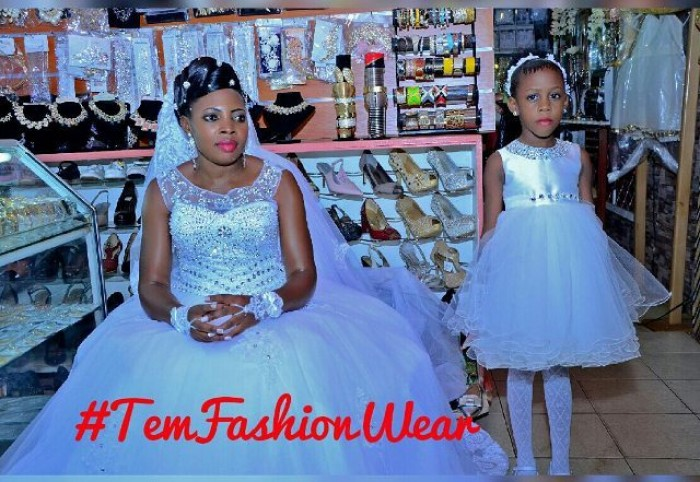 A bride and her flower girl dressed by TEM Fashion WEAR