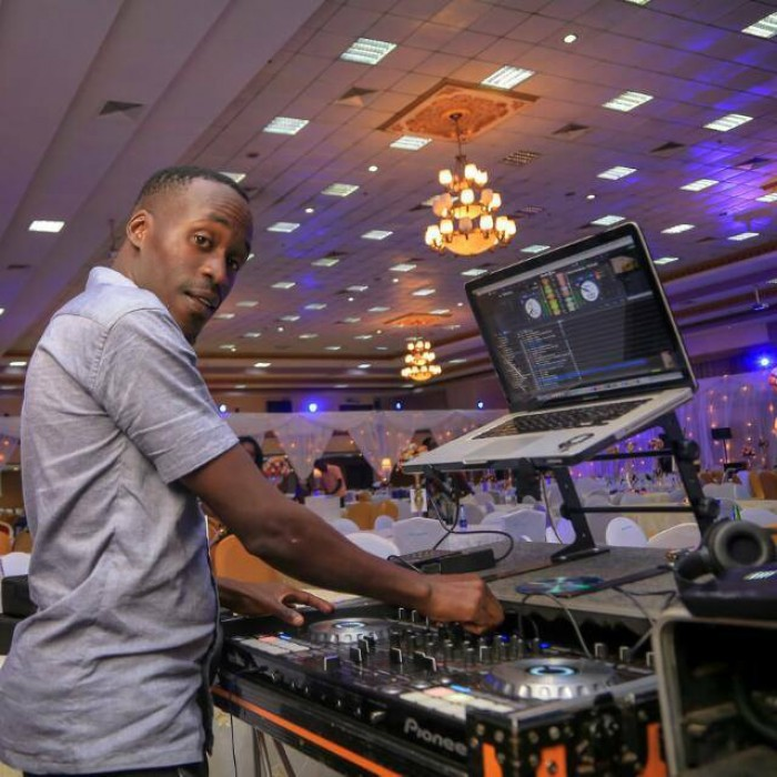 A deejay playing music at a wedding