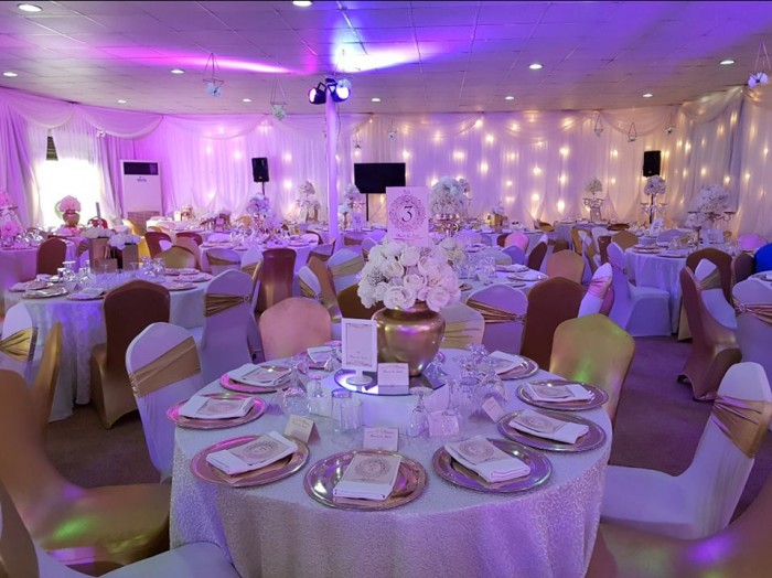 Gold and white wedding decorations at Rivonia Suites