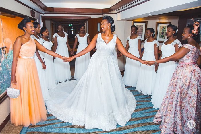 A bride poses for a photo with her entourage at Speke Resort Muyonyo