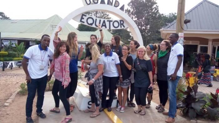 Tourists at the Equator along the Kampala-Masaka highway in Uganda