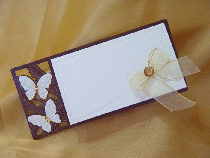 A butterfly inspired wedding card designed by Chic Designs