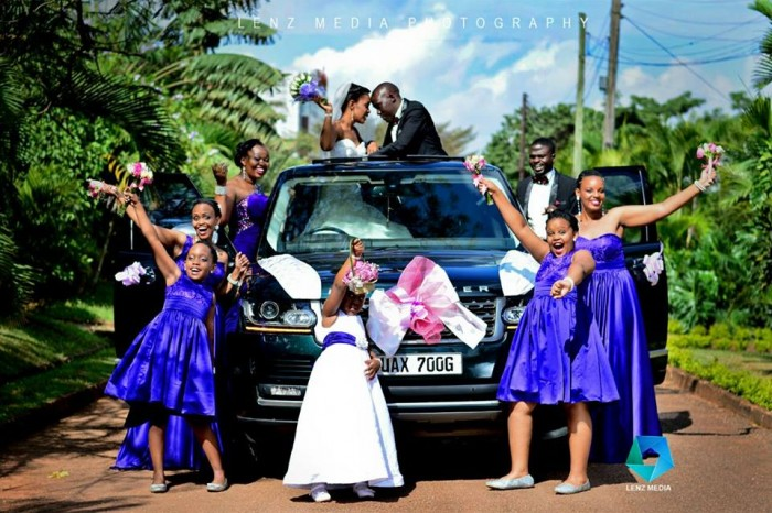 Bridal Entourage with bridesmaids in blue dresses captured by Lenz Media