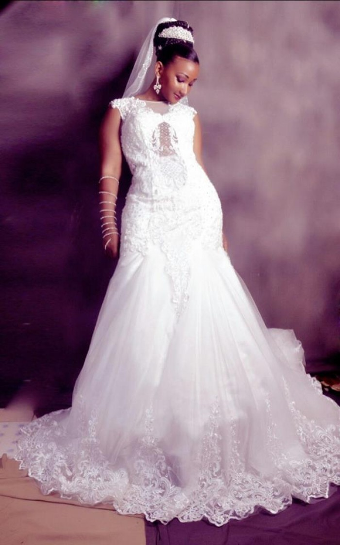 A model bride in a mermaid wedding dress by Aggie's Bridal