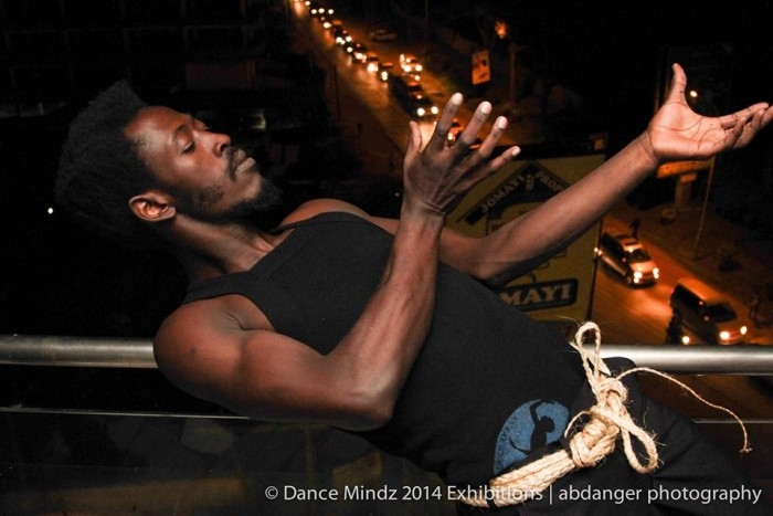 A guy dances at the Dance Mindz 2014 Exhibition in Kampala, Uganda