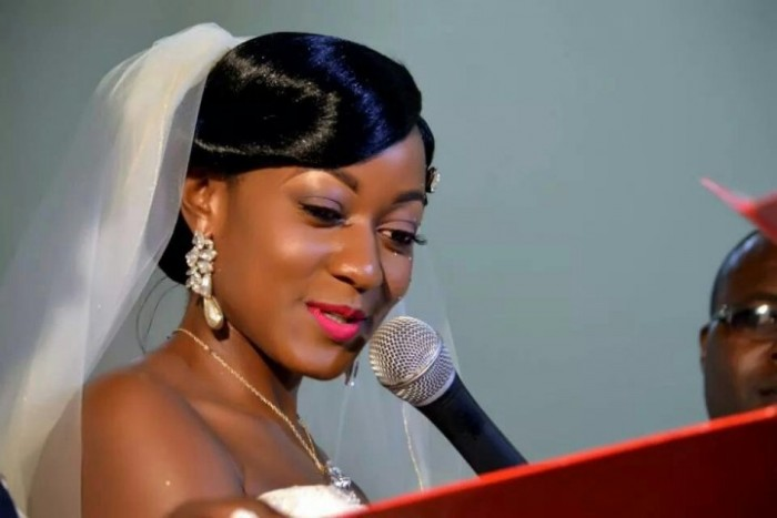A bride saying her vows in church, makeup & salon done by Salon lords and ladys