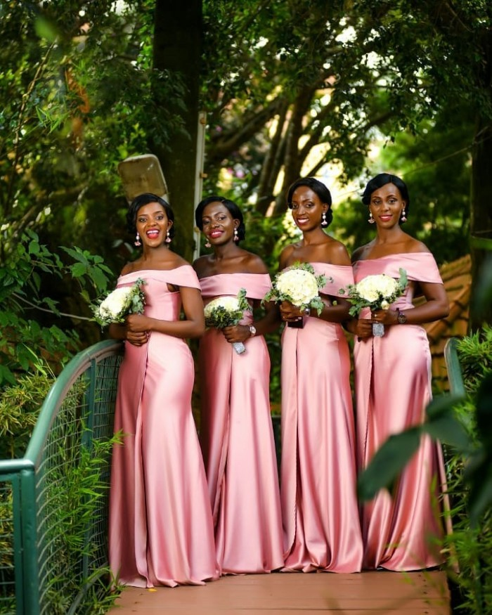 Bridesmaids cloaked in sleek off-should dresses, shots Devine Photography