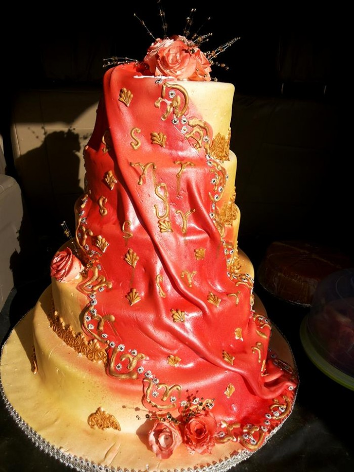A red wedding cake baked by NHK Home Bakery