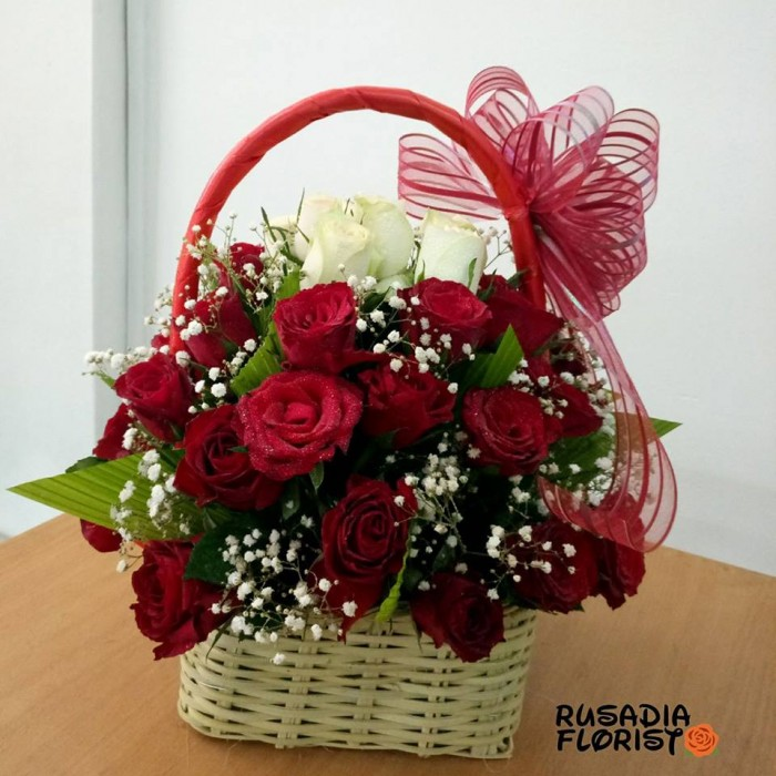 A basket of red and white roses from Rusadia Florists and Decorations