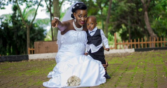 A bride and her pageboy during a wedding photo shoot powered by Frame Media