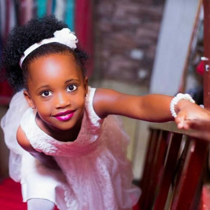 A gorgeous flower girl dressed by TEM Fashion WEAR