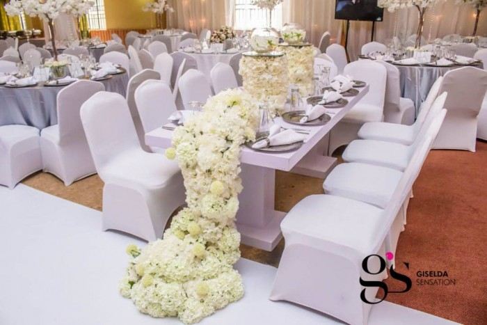 Joshua and Faridah's white wedding decor at Silver Springs Hotel
