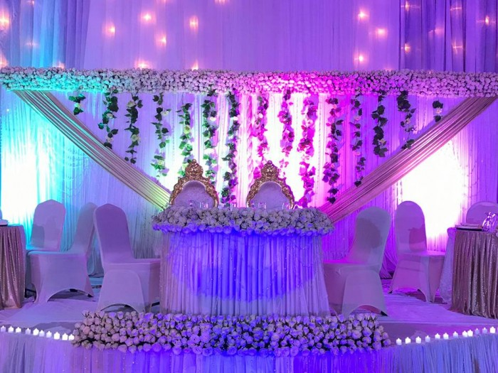 Wonderful wedding high table decorations done by SPICE Decorators & Events Managers