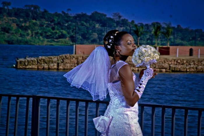 A beautiful Ugandan bride at a wedding photo shoot at the Commonwealth Resort Munyonyo