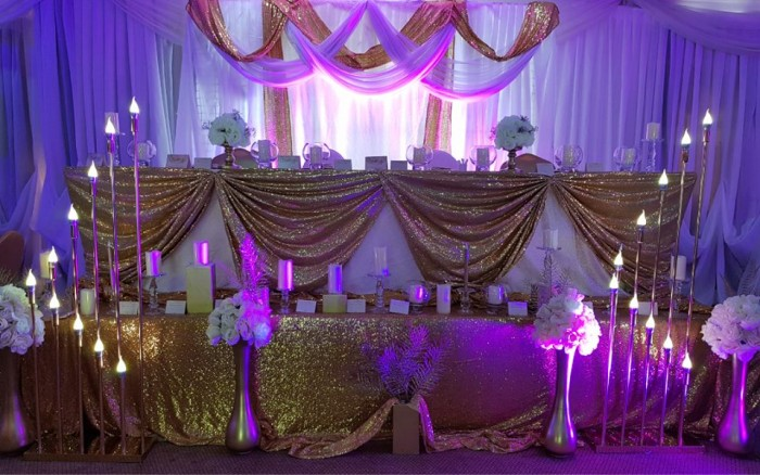 Gold and White inspired wedding high table decorations at Rivonia Suites
