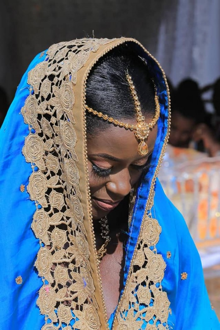 Kuhingira bride dressed by Peponi Clothing
